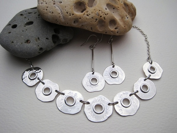Silver necklace and earrings with saw pierced centre and soldered wire detail