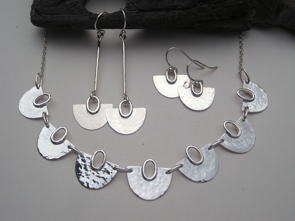 Half round seven section silver necklace and earrings