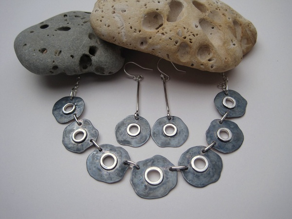 Oxidised silver necklace and earrings with saw pierced centre and soldered wire detail